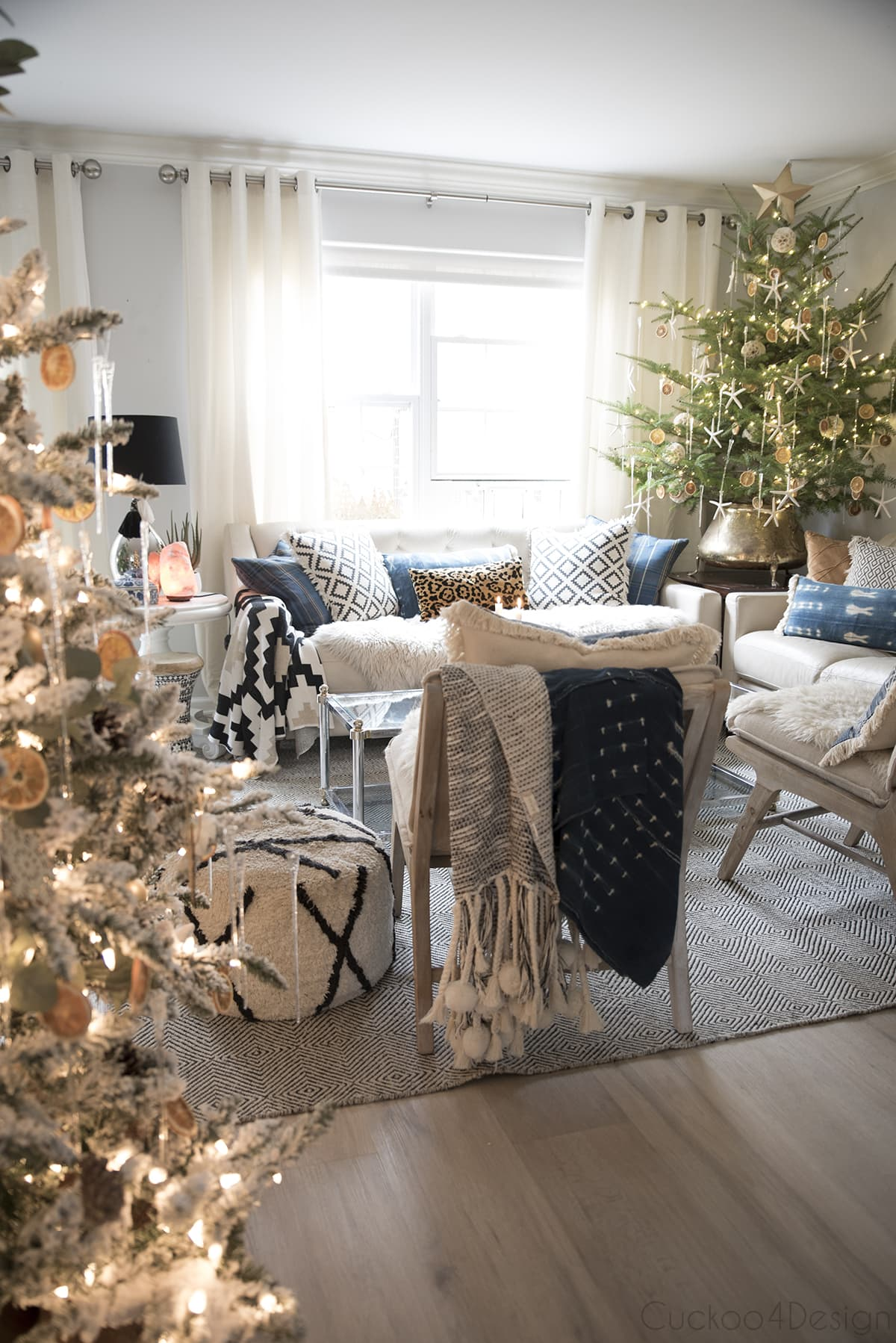 layered and textured living room with live tabletop Christmas tree
