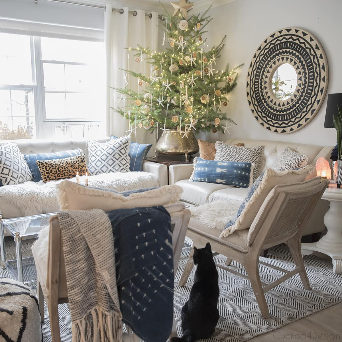 large live tabletop Christmas tree in boho chic living room