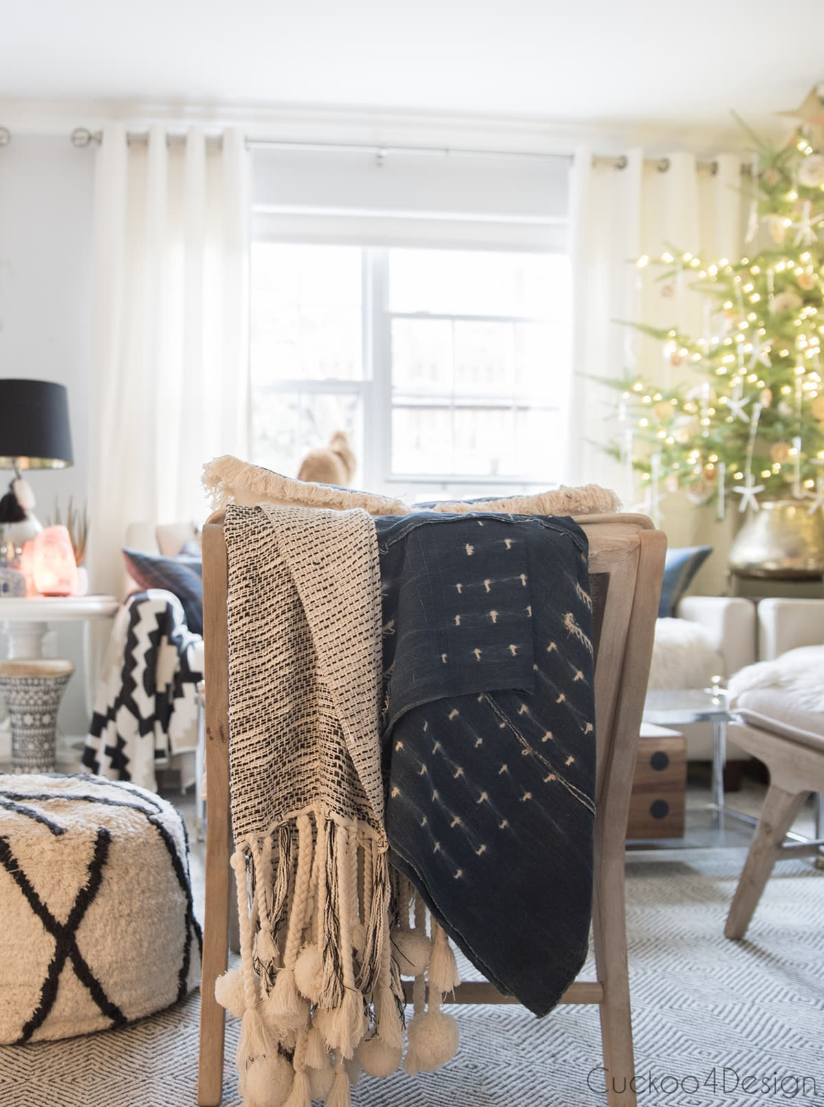 throw blankets over chair in boho living room