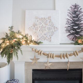 snowflake and pinecone DIY Christmas canvas paintings