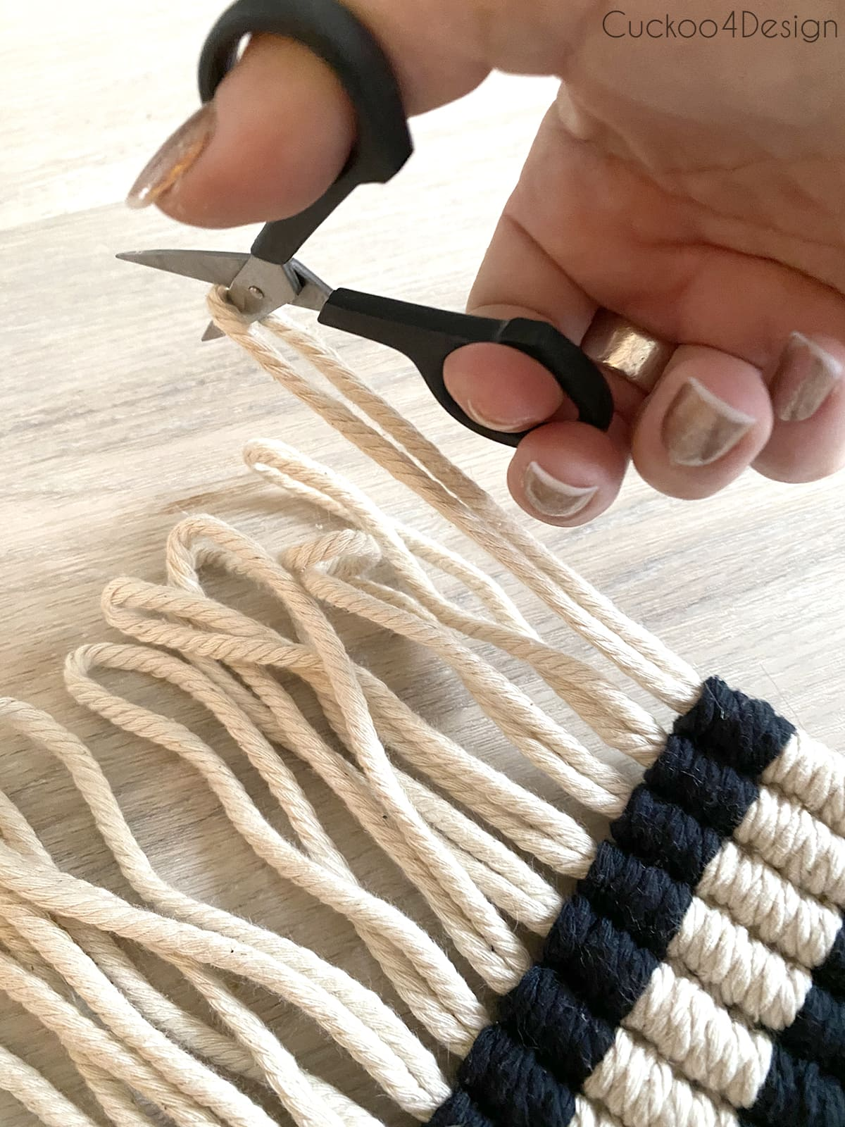 cutting the loops of macrame