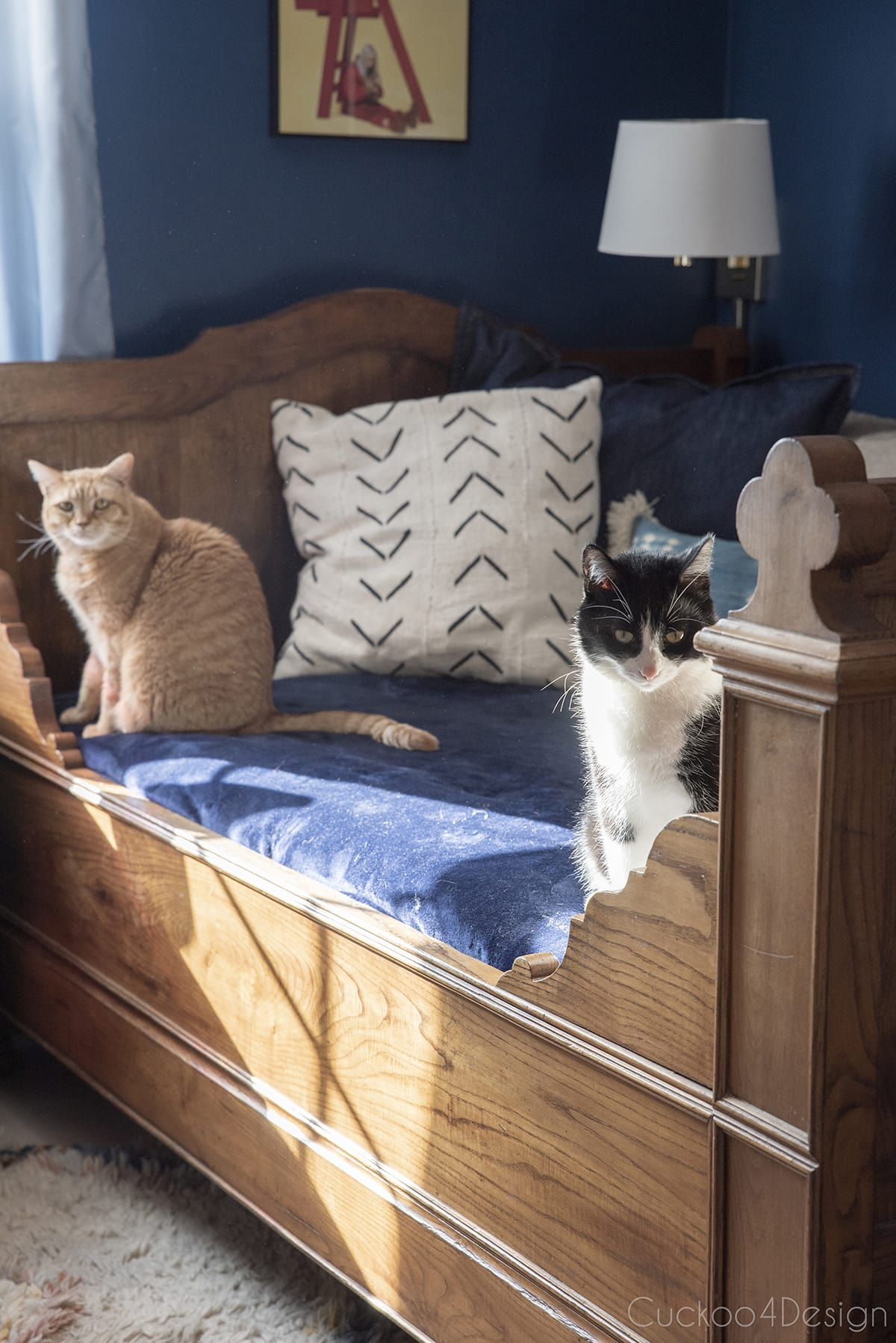 cats hanging out on our French antique bed