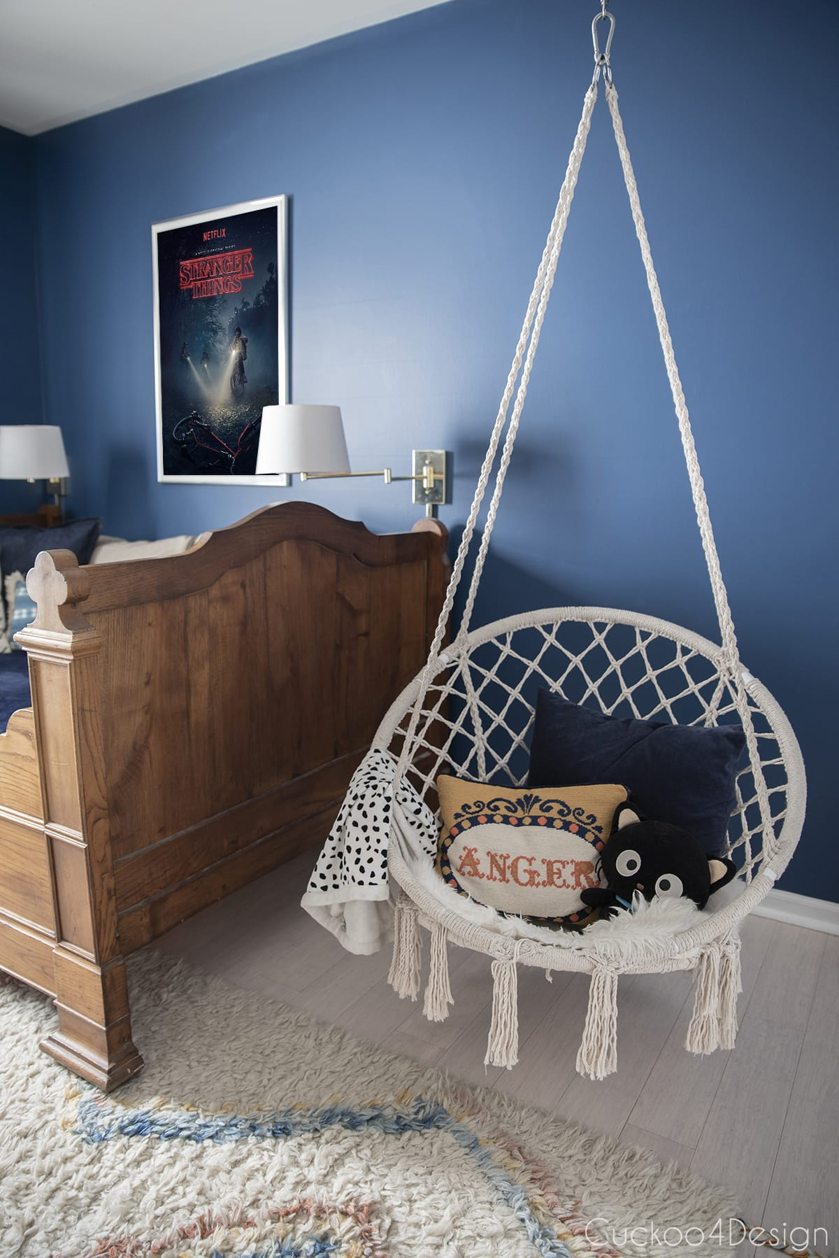 macrame hanging chair in girls bedroom with French antique bed