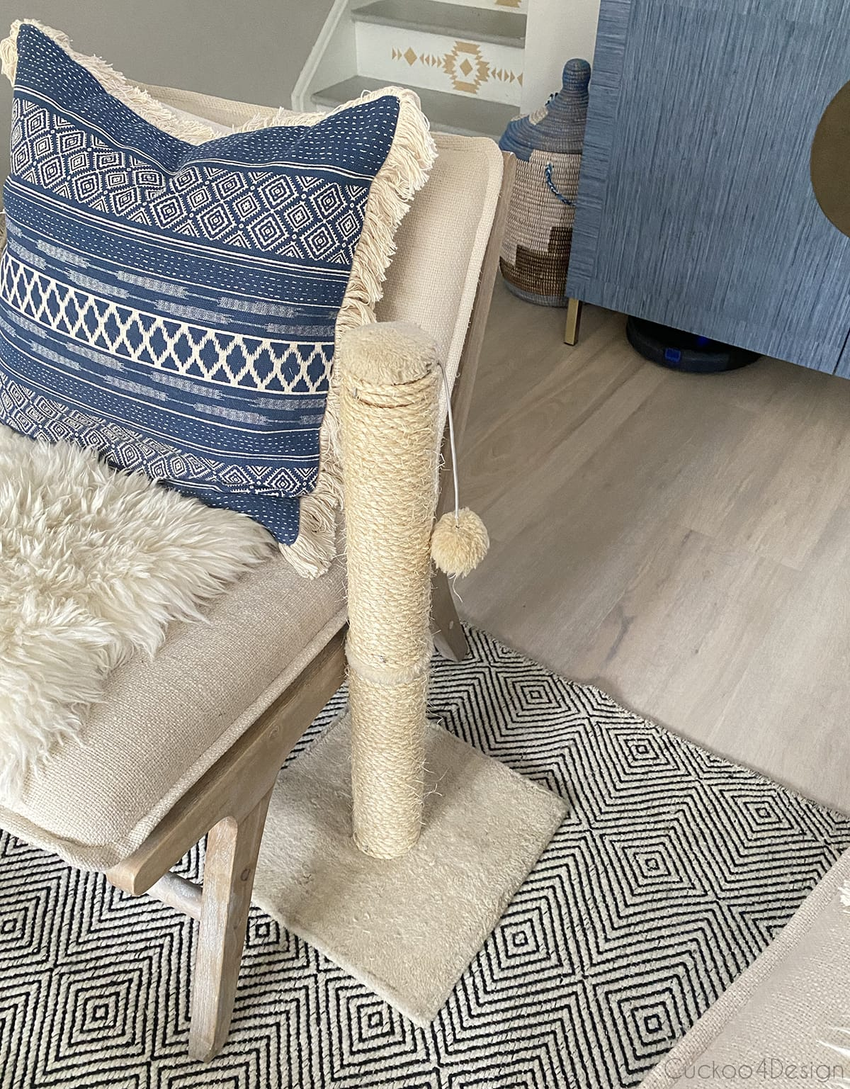 cat scratching post next to chair