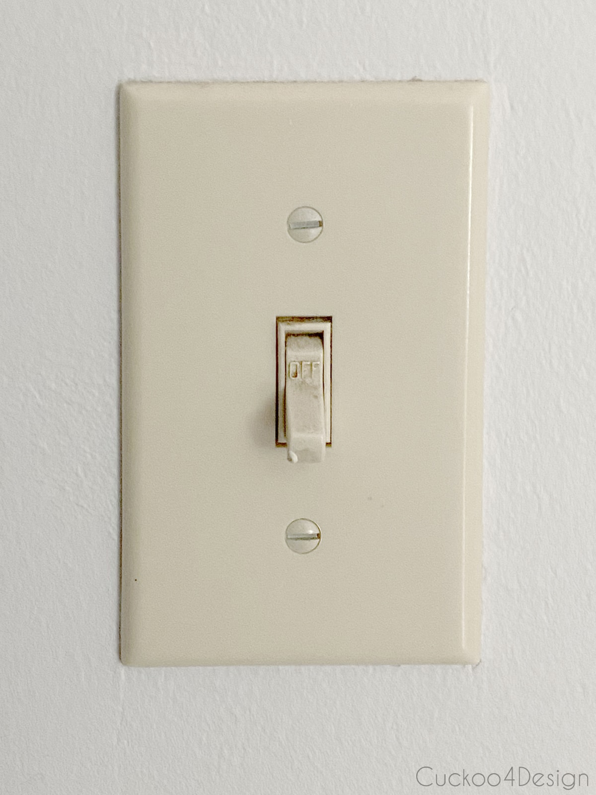 yucky old tan light switch cover