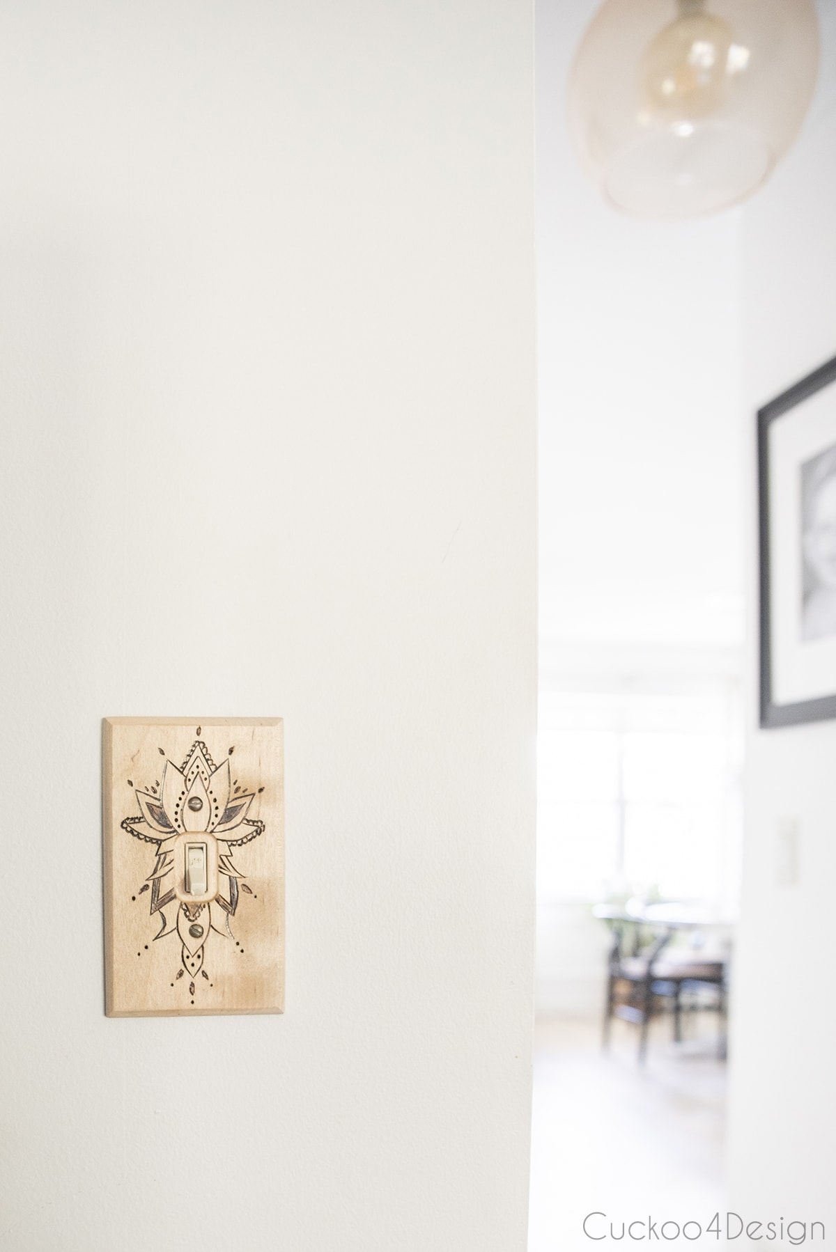 closeup of wooden DIY light switch cover on the wall