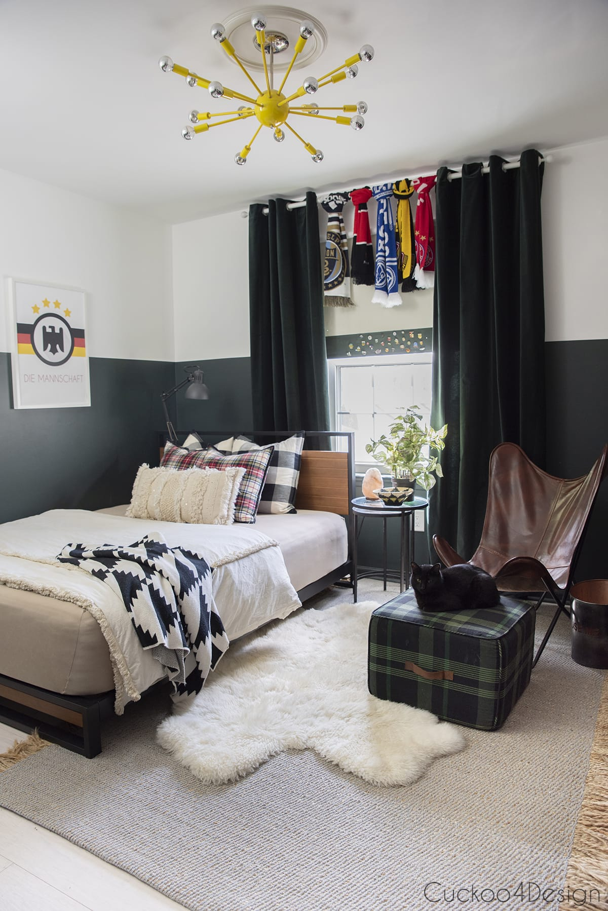 dark green boys bedroom with soccer scarf collection on curtain rod