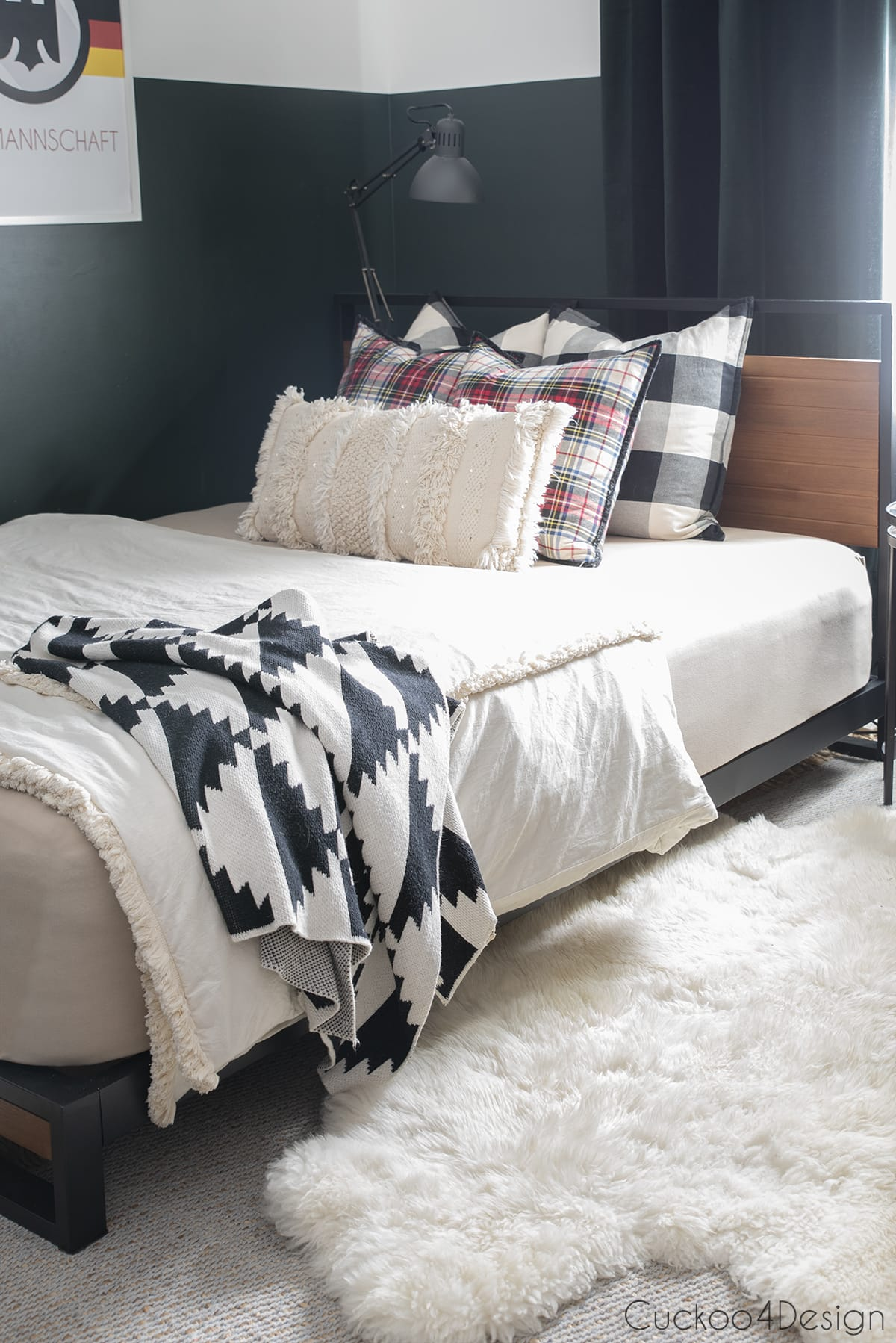 mixed plaid pattered pillows on modern wood and metal platform bed