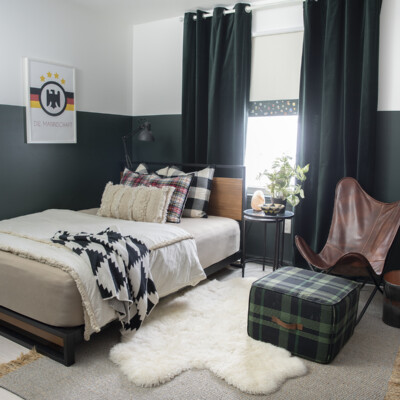 modern wood and metal platform bed in our son's dark green room