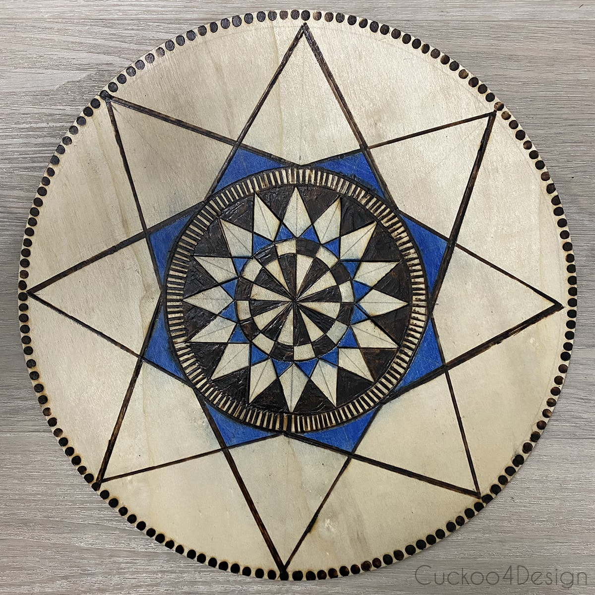 wood burned geometric wall art in Pennsylvania Dutch hex sign style