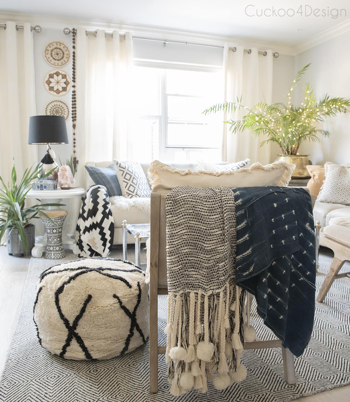 fairy lights in palm tree in neutral boho living room