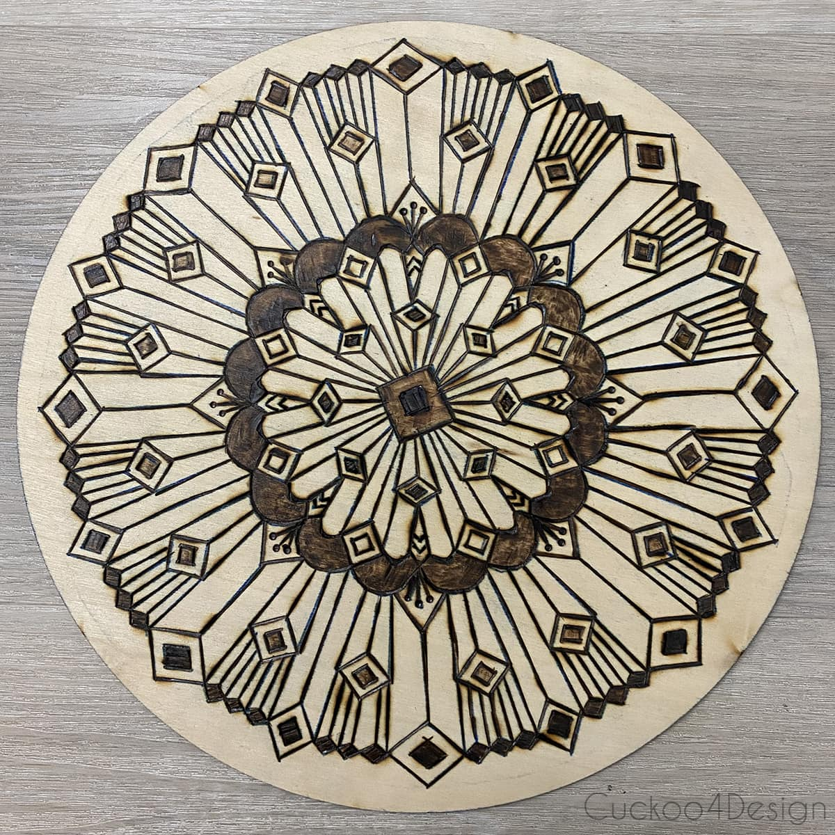 finished wood burned mandala with straight lines and without color