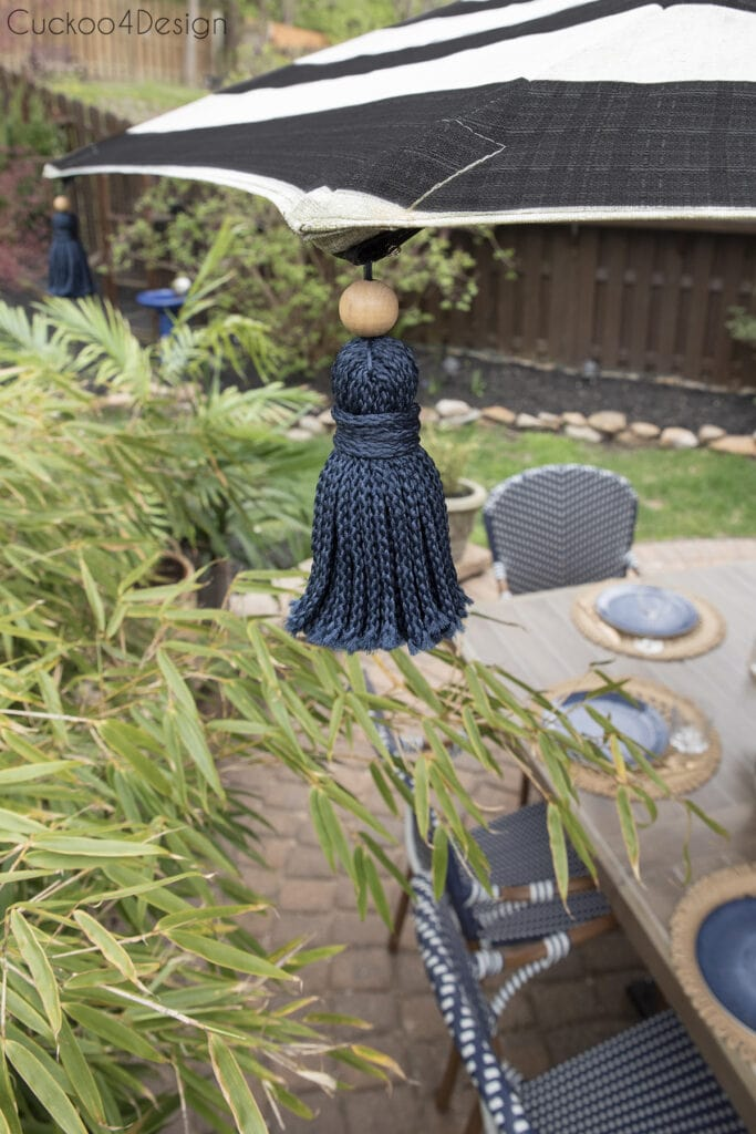 sideview of the tassel umbrella with cat enclosure in the background
