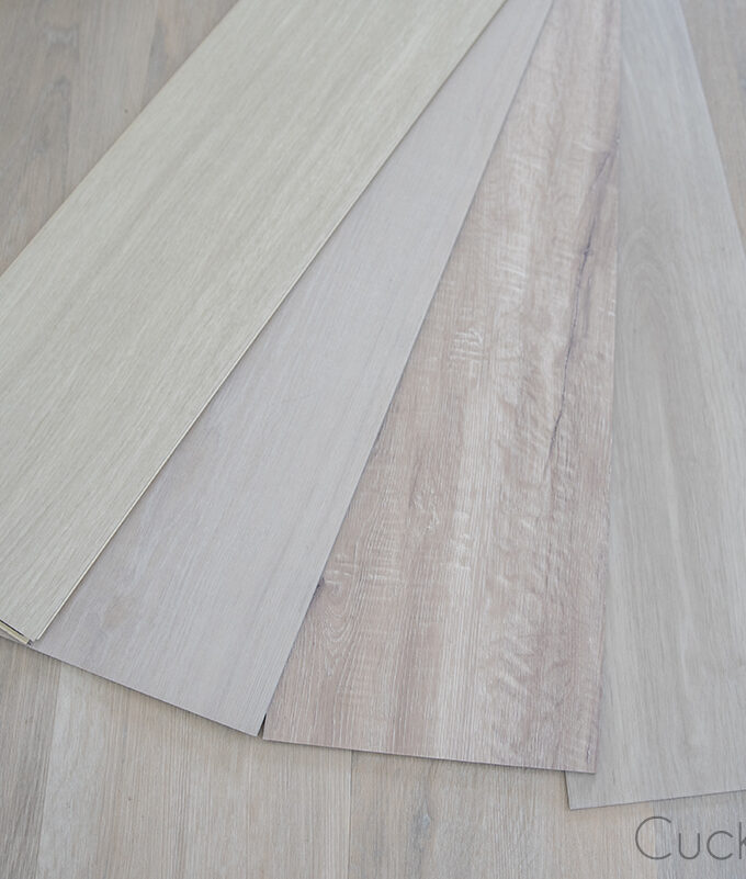 comparing different light colored vinyl plank samples