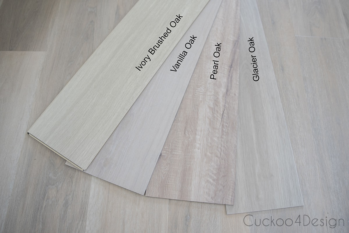 comparing different light colored wood vinyl plank flooring samples in a fan with descriptions