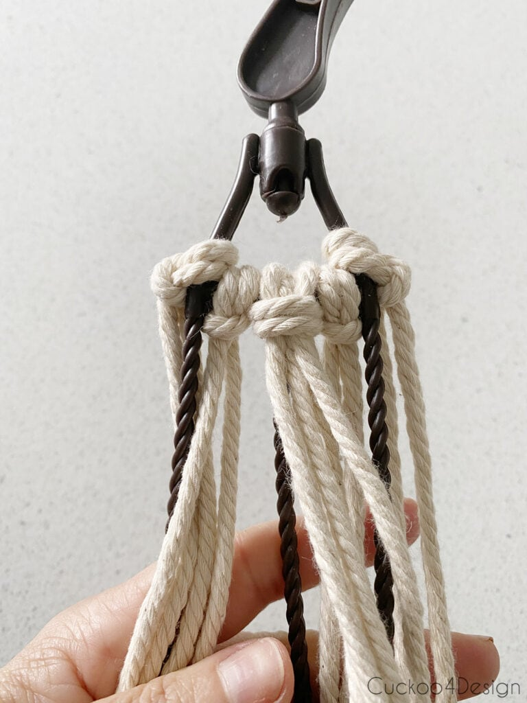 front view of Lark's Head knots on plastic hook