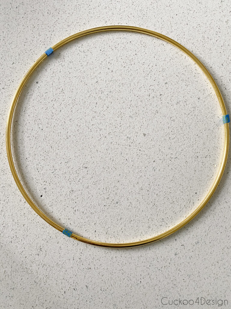 marking spots for macrame spirals on brass ring with tape