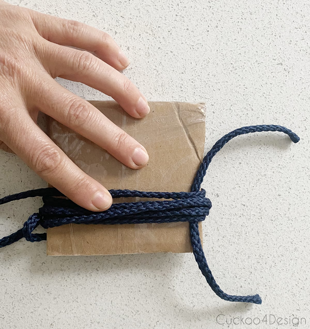 starting the tassel by wrapping yarn around cardboard
