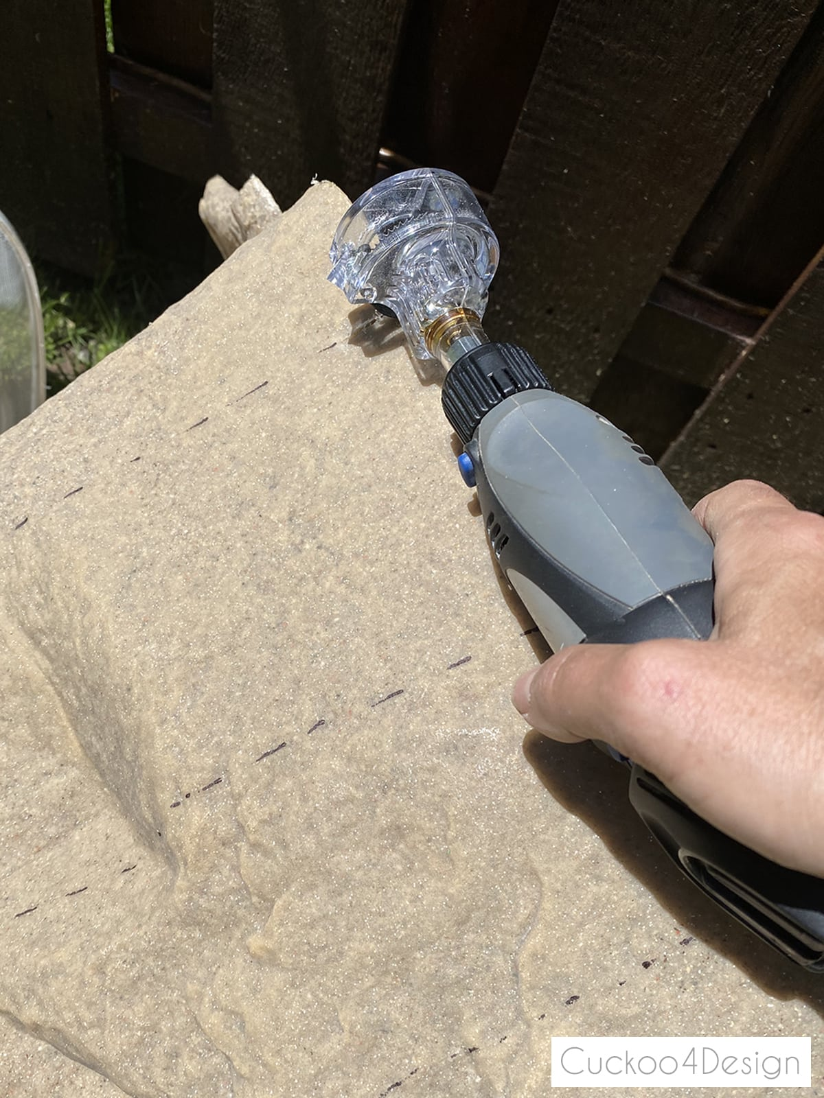 cutting hole into pump cover with Dremel mini saw