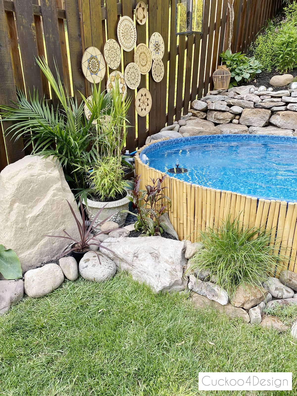 faux rock pool pump cover with hoses hidden by potted plants