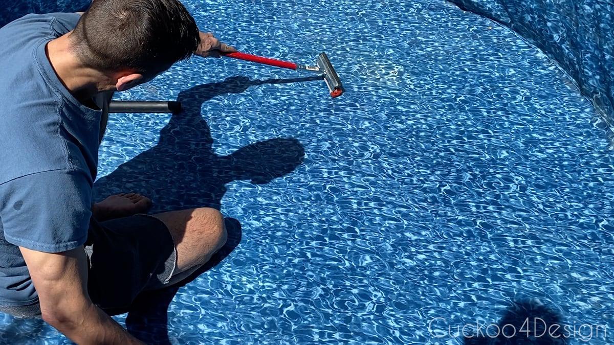 squeegeeing water behind pool liner towards shop vac hose