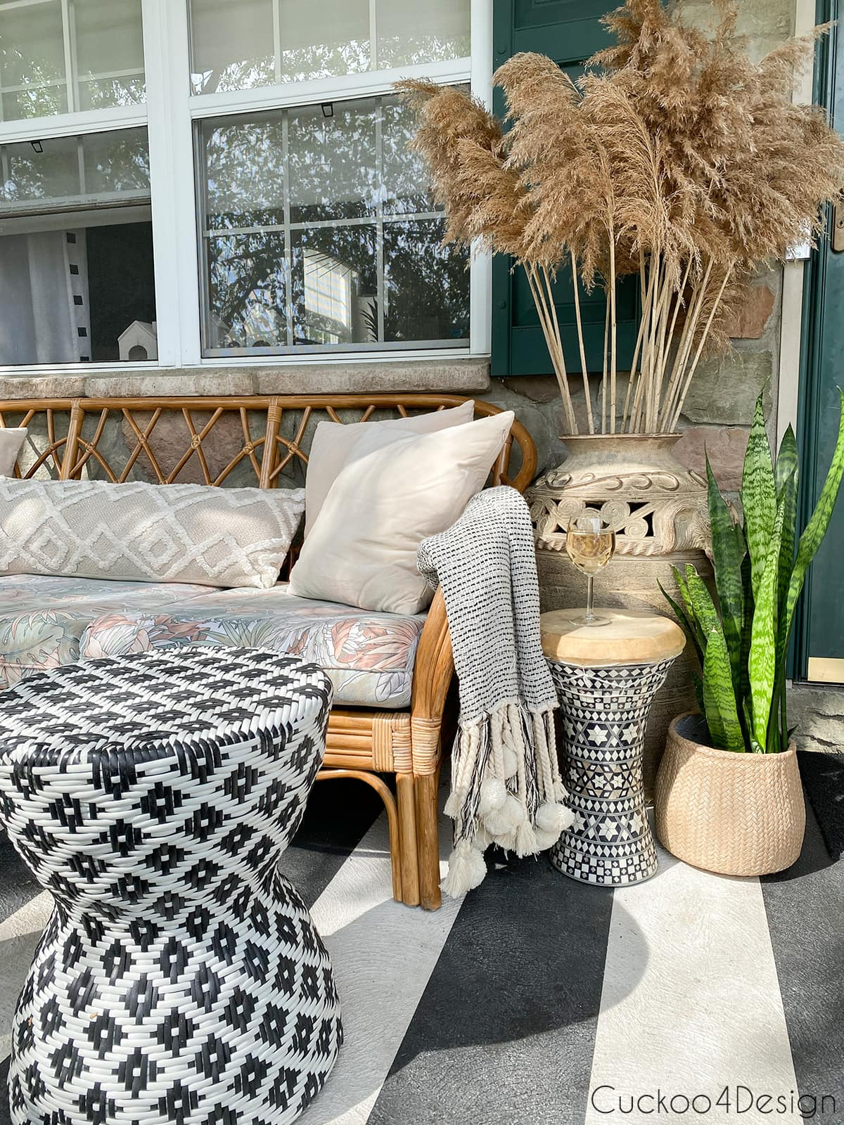 black and white striped front porch with boho accents