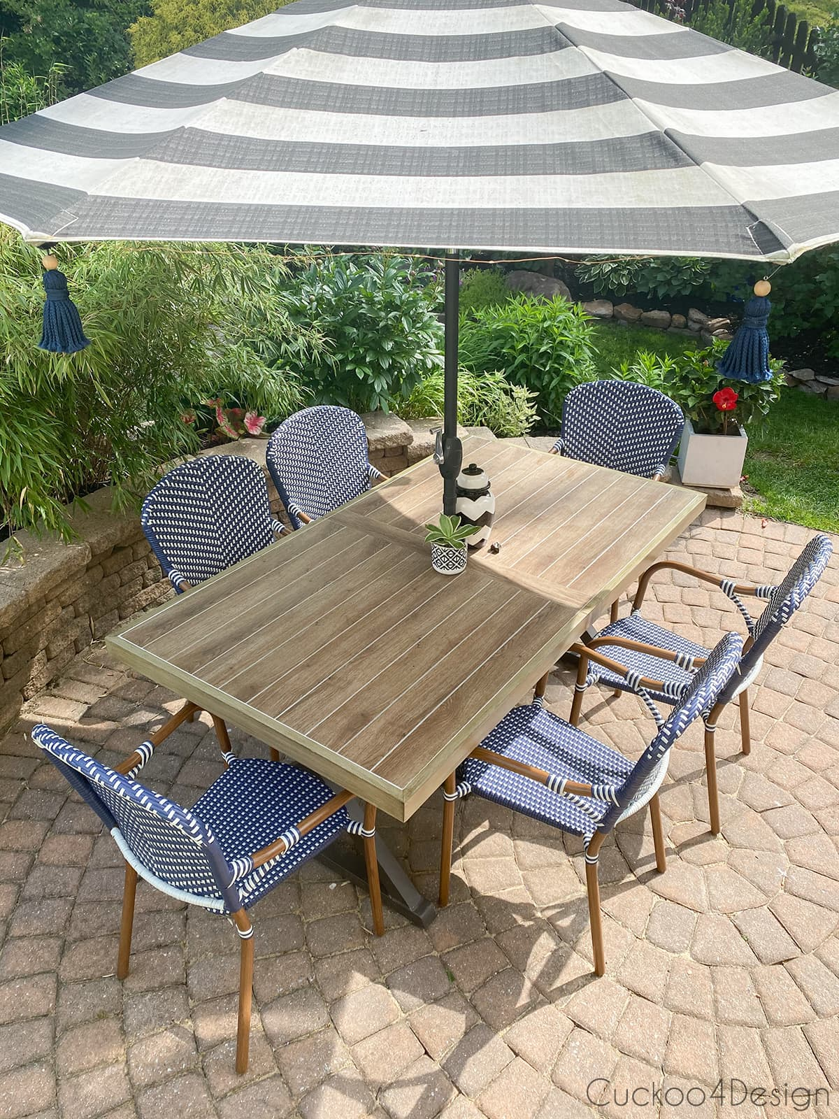 faux tile patio table with blue and white French bistro chairs
