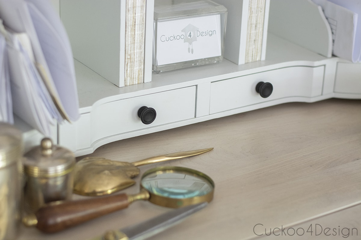white cubbies of the lightened cherry wood desk