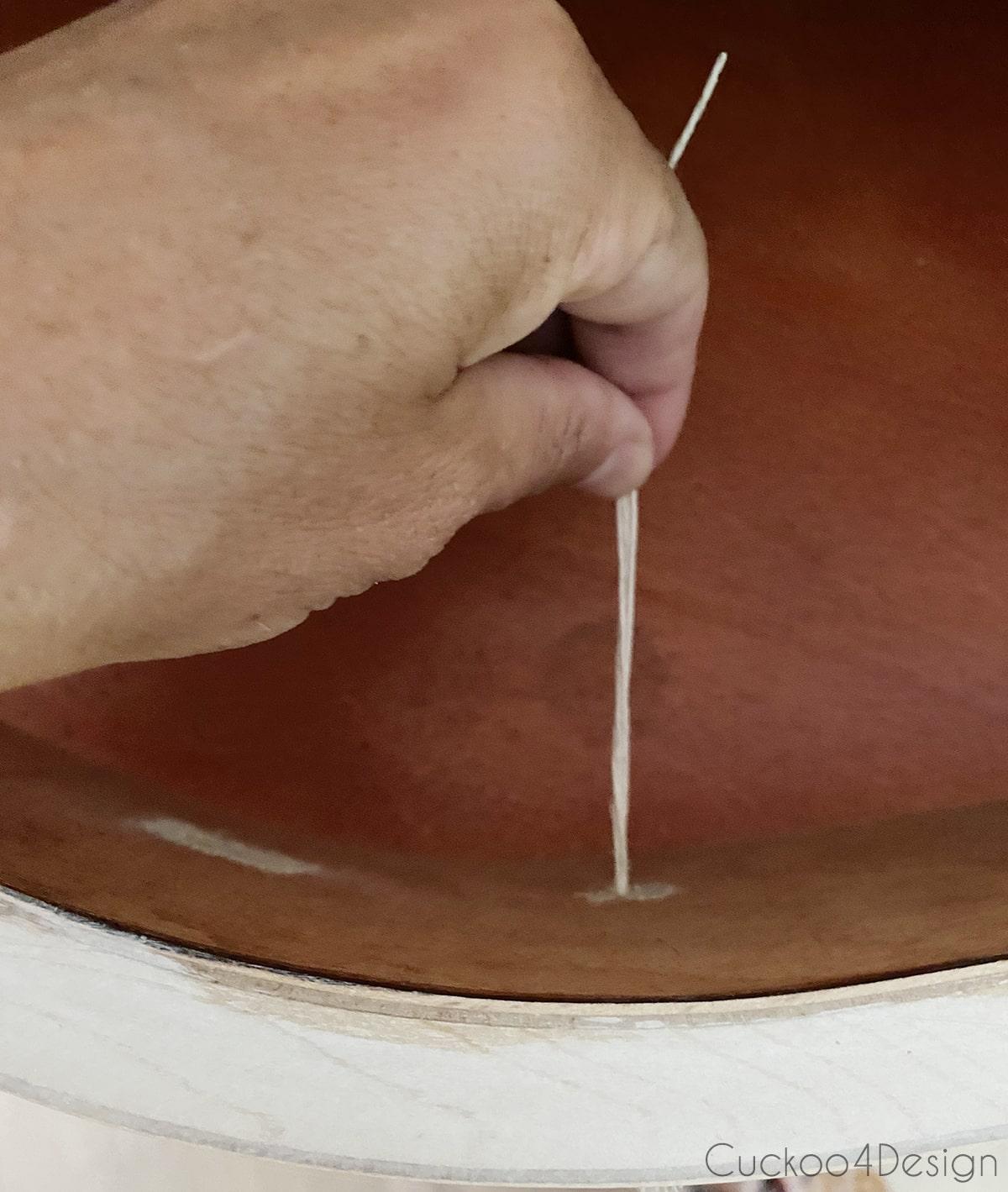 threading hemp cord through dresser hardware holes