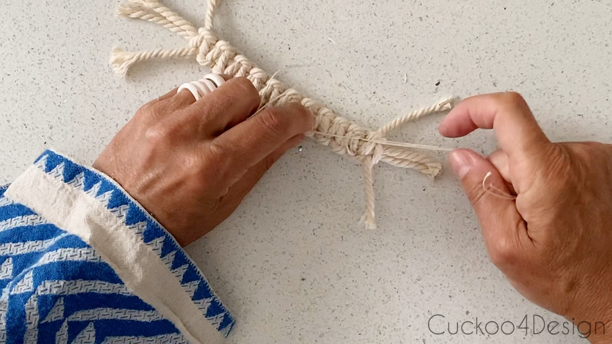 tying knot on hemp cord to keep Square Knots in place
