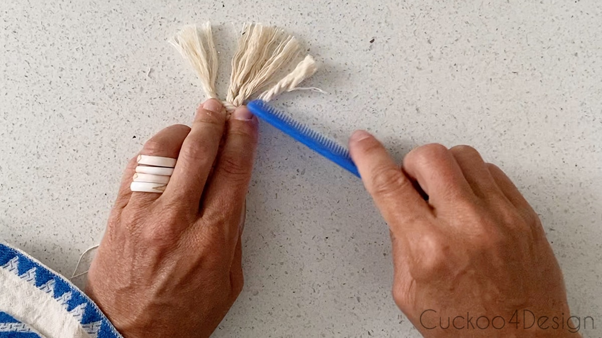 opening up and combing macrame cord to create fringe on the ends of macrame dresser drawer pulls