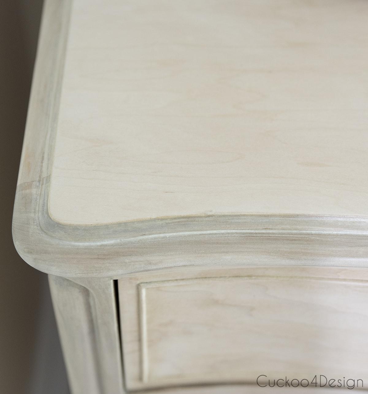 corner of wood bleached dresser