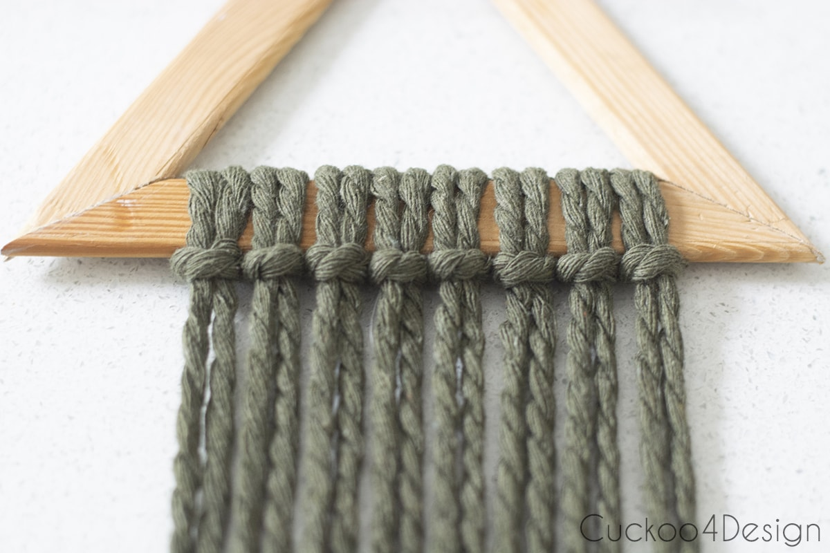 lark's head knots at the top of modern macrame wall hanging