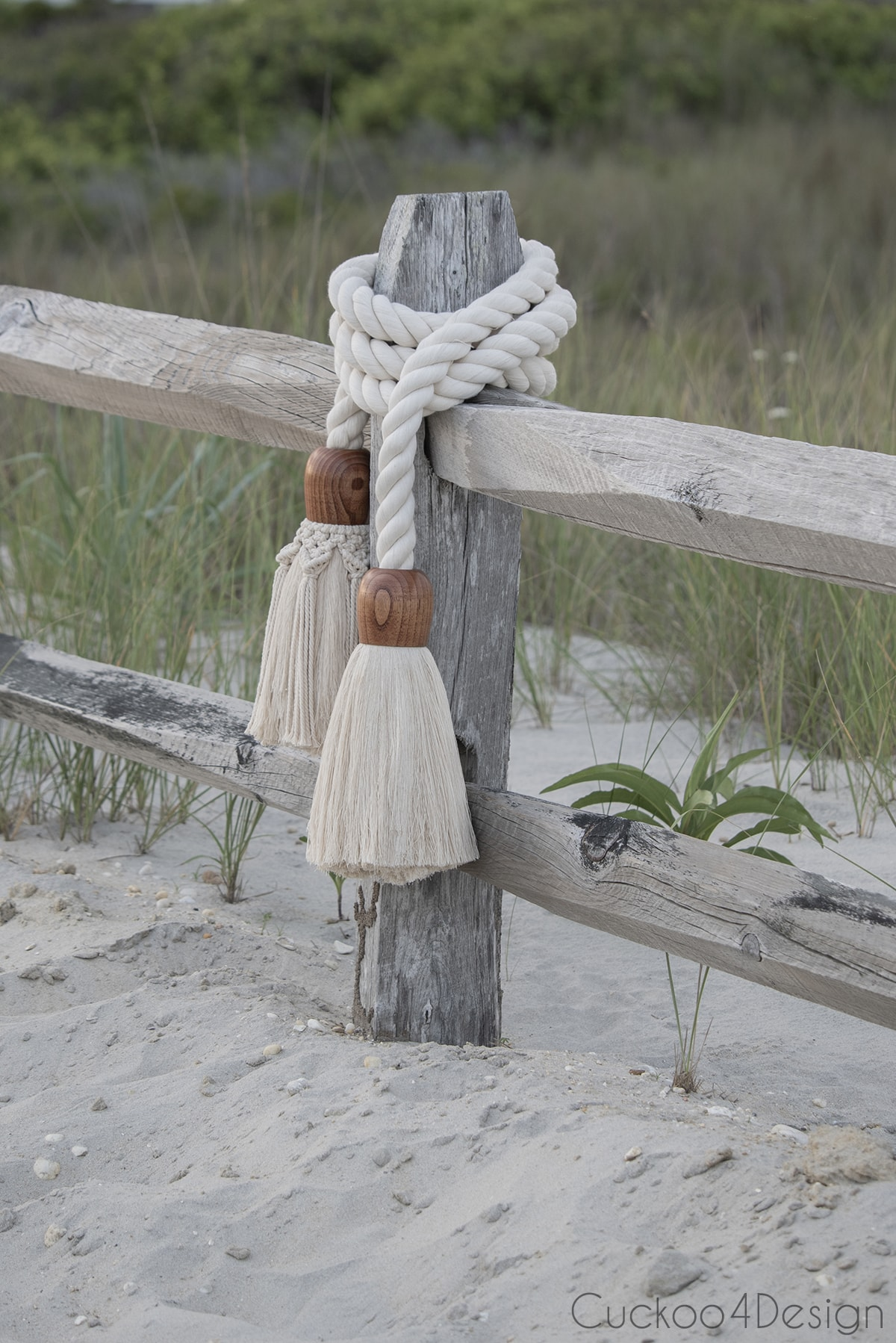 distant view of giant cotton rope macrame tassel garland towards the dunes