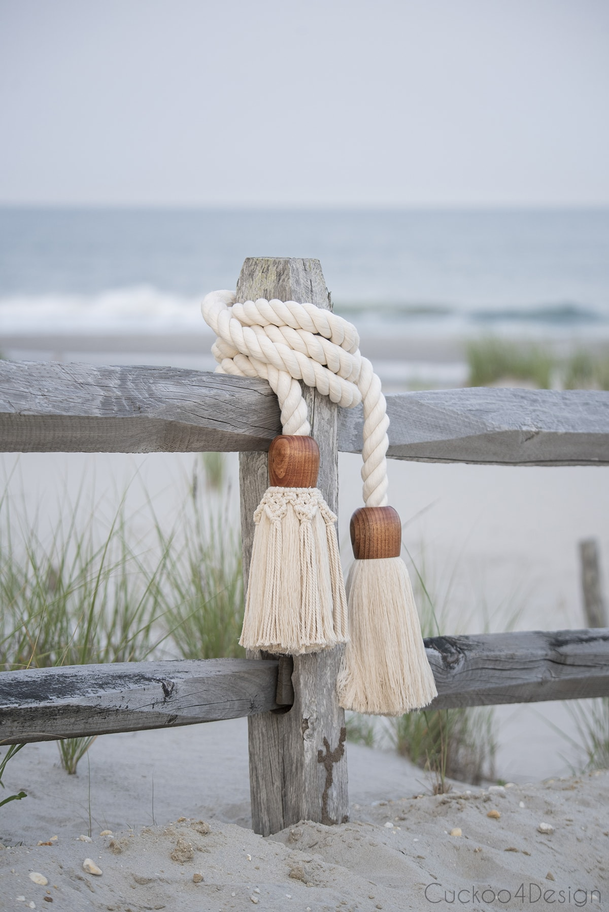 view of giant cotton rope macrame tassel garland towards the beach