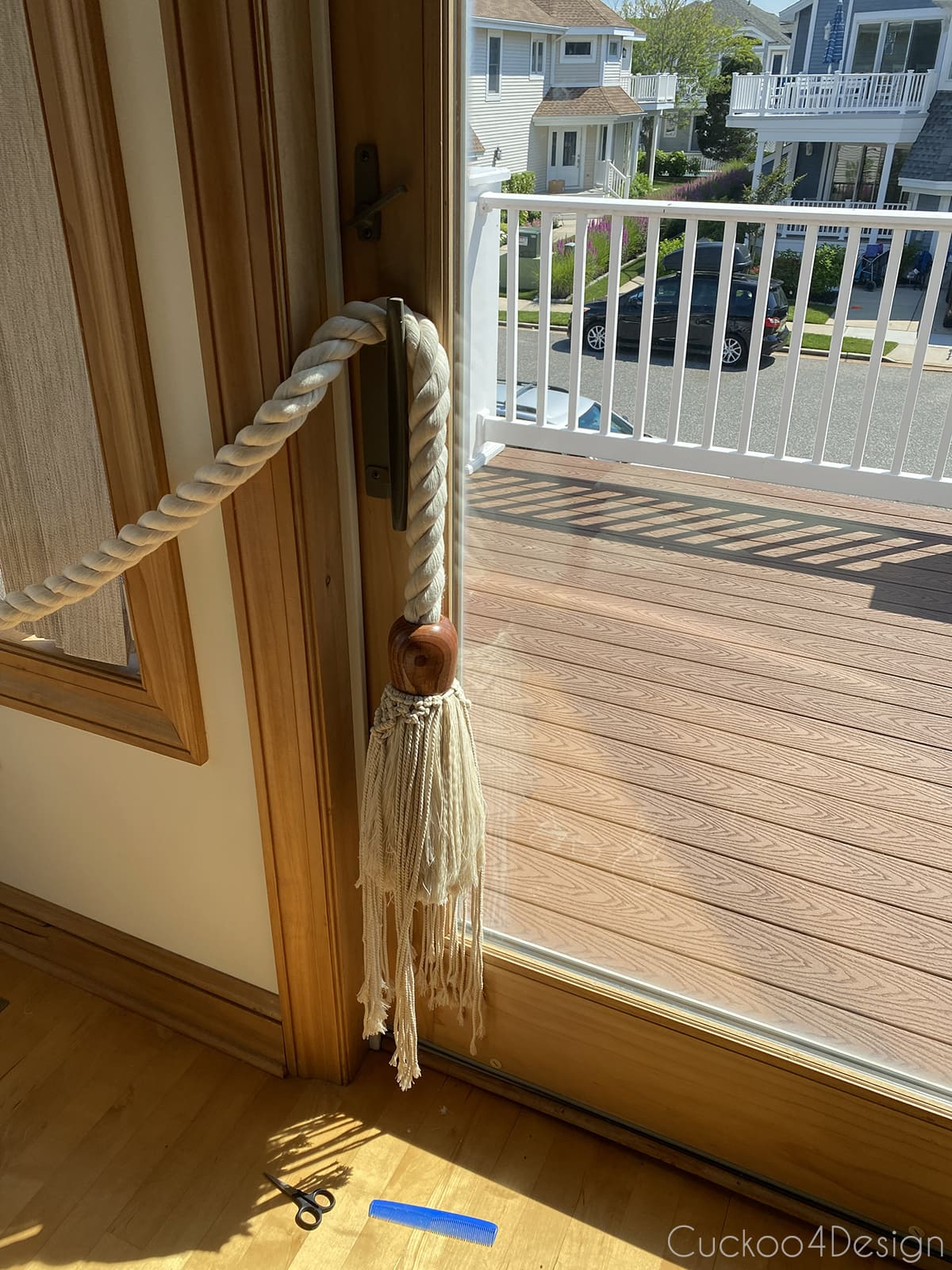 tying macrame garland onto cotton rope tassel garland
