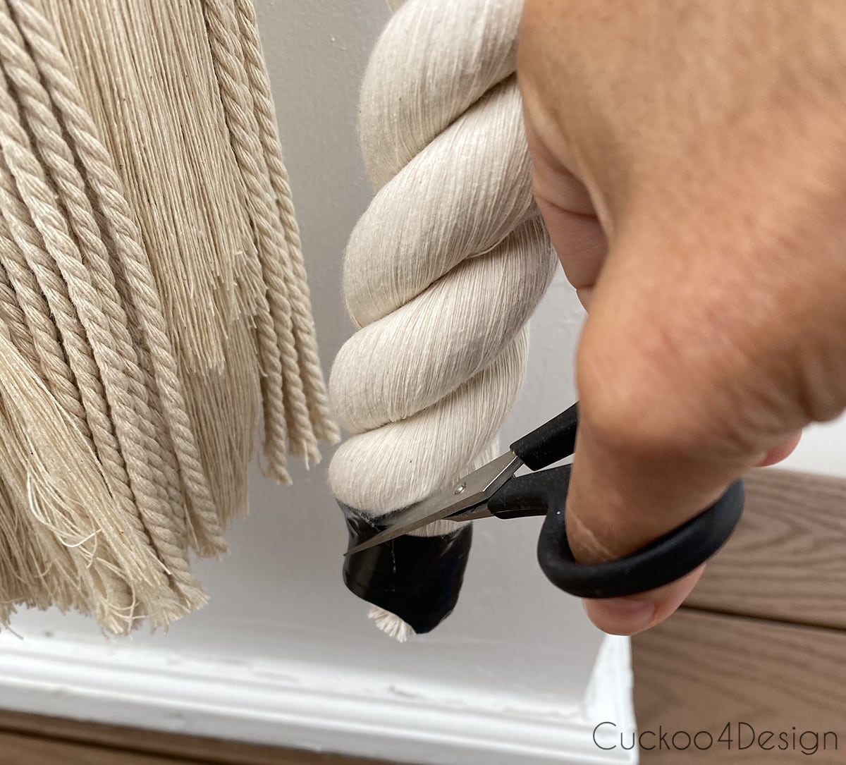 cutting tape at the bottom of the cotton rope