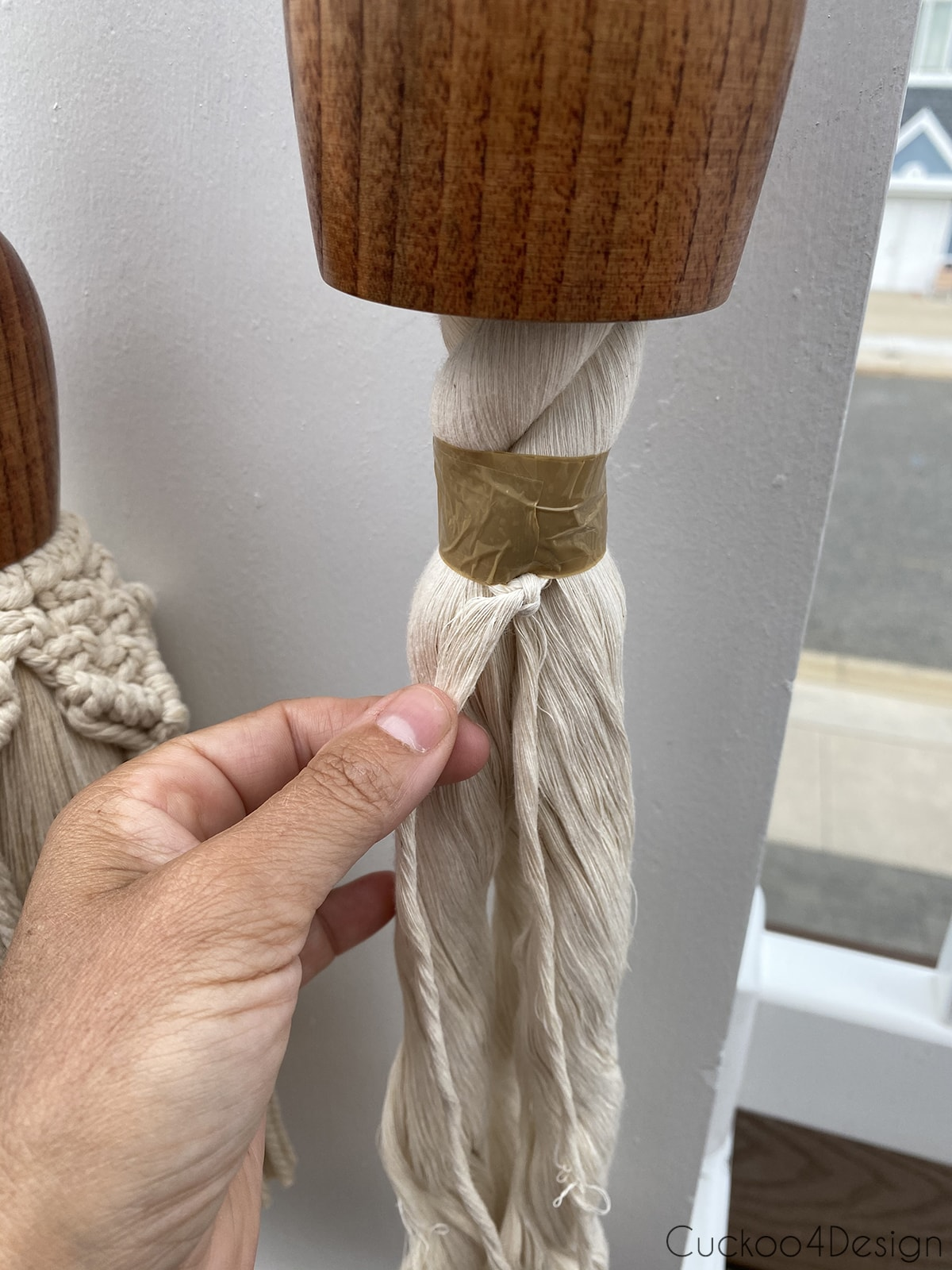 knotting pieces of cotton rope
