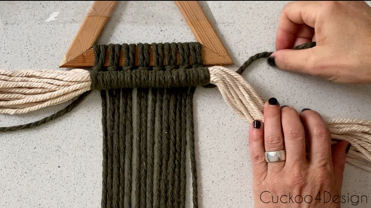 tucking strands behind macrame piece for a staggered look