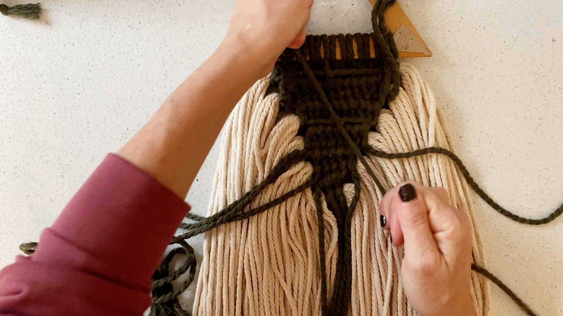 knotting the ends of dark green macrame cord