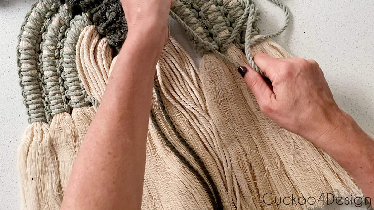 knotting the back of the modern macrame wall hanging