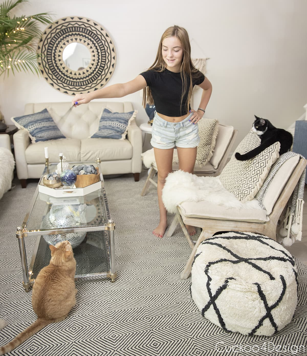 our daughter playing with the cats