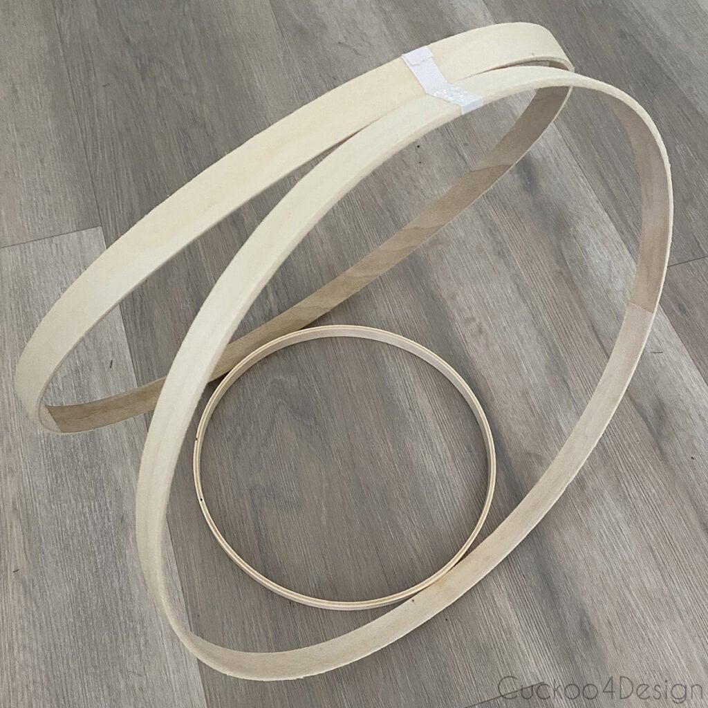 smaller hoop wedged between two larger hoops