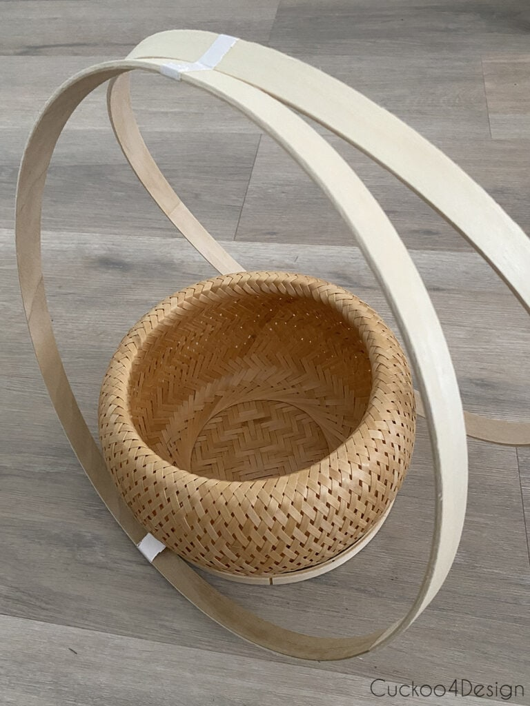 basket sitting inside smaller hoop