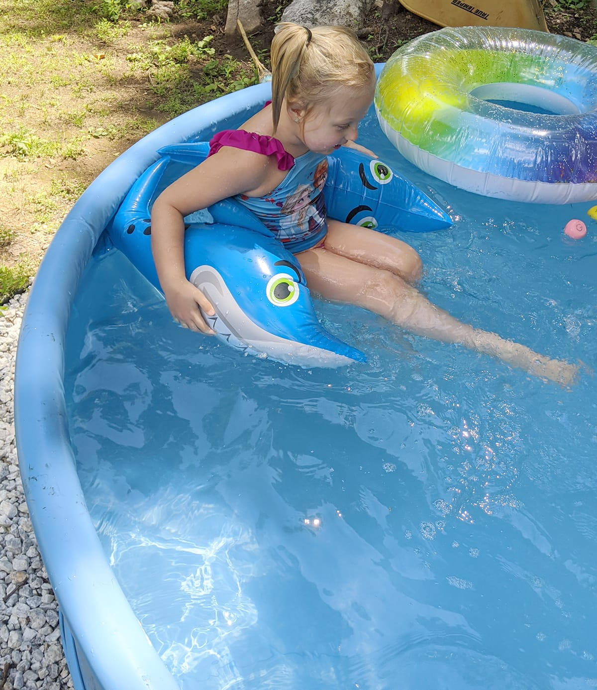 lined stock tank pool with child swimming in it