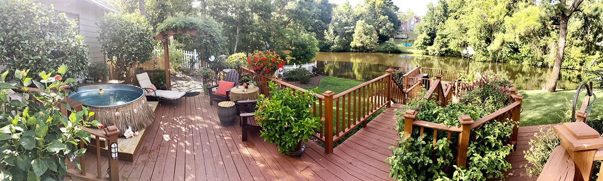 panoramic view of deck with stock tank pool