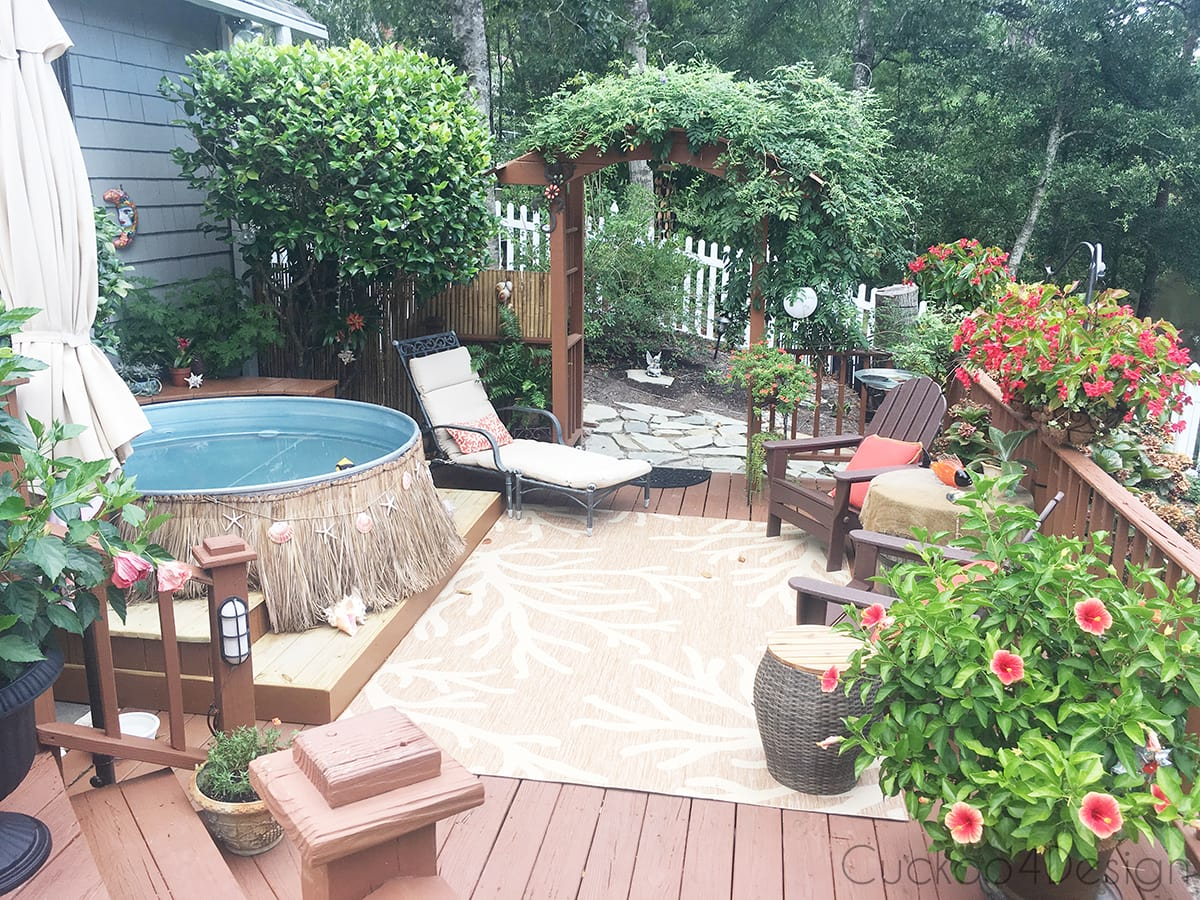 view of the entire deck with stock tank pool