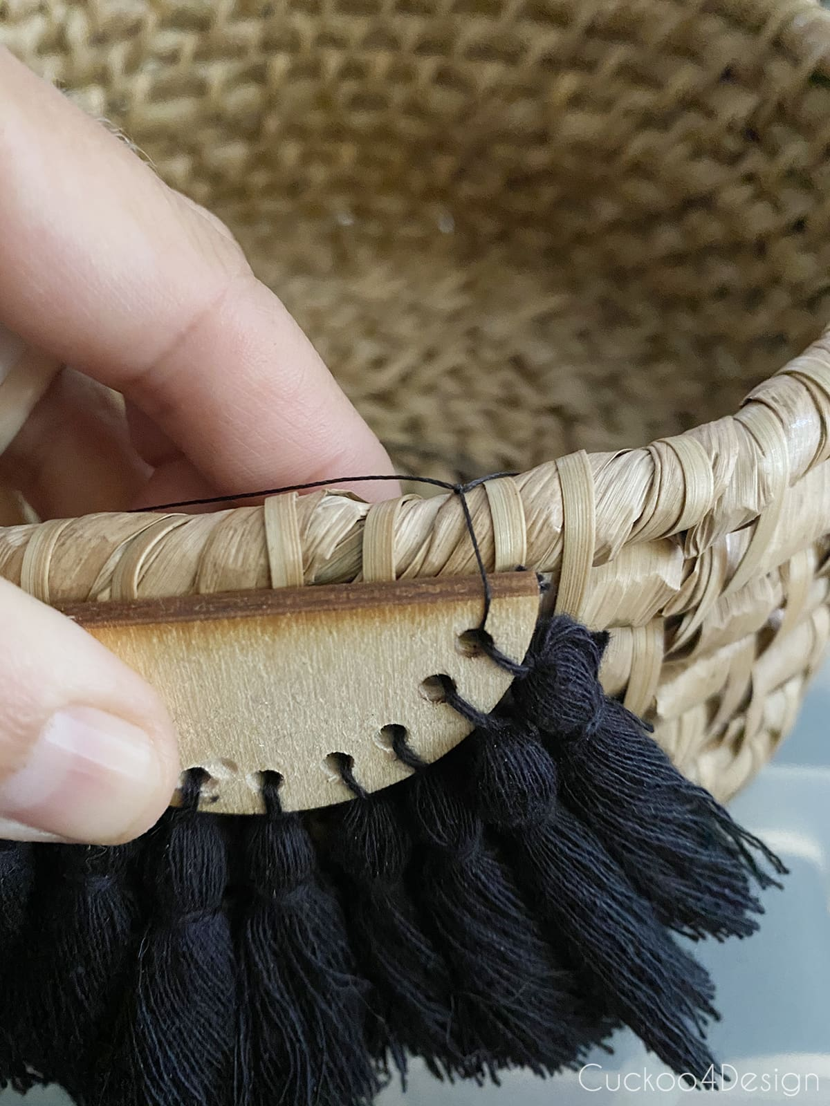 view of attached half-moon tassel embellishment