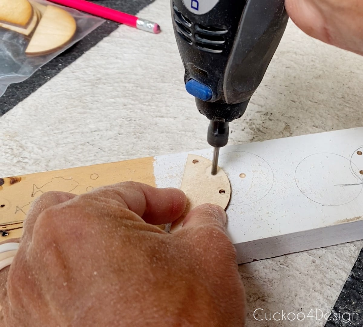 drilling holes into wooden half-moon