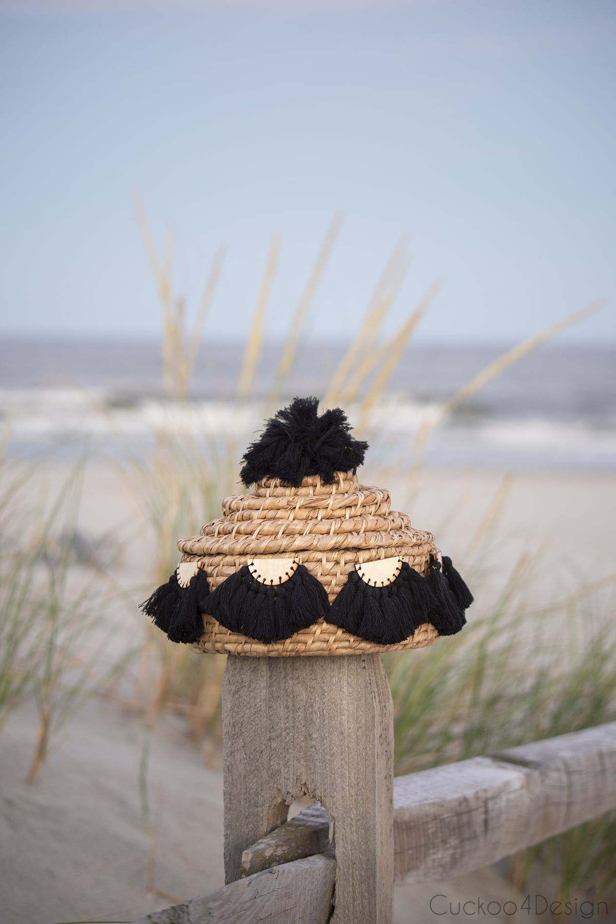 basket with pom pom and half-moon tassel embellishments